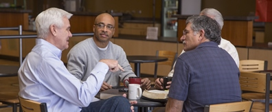 group-of-men-talking-in-coffee-shop